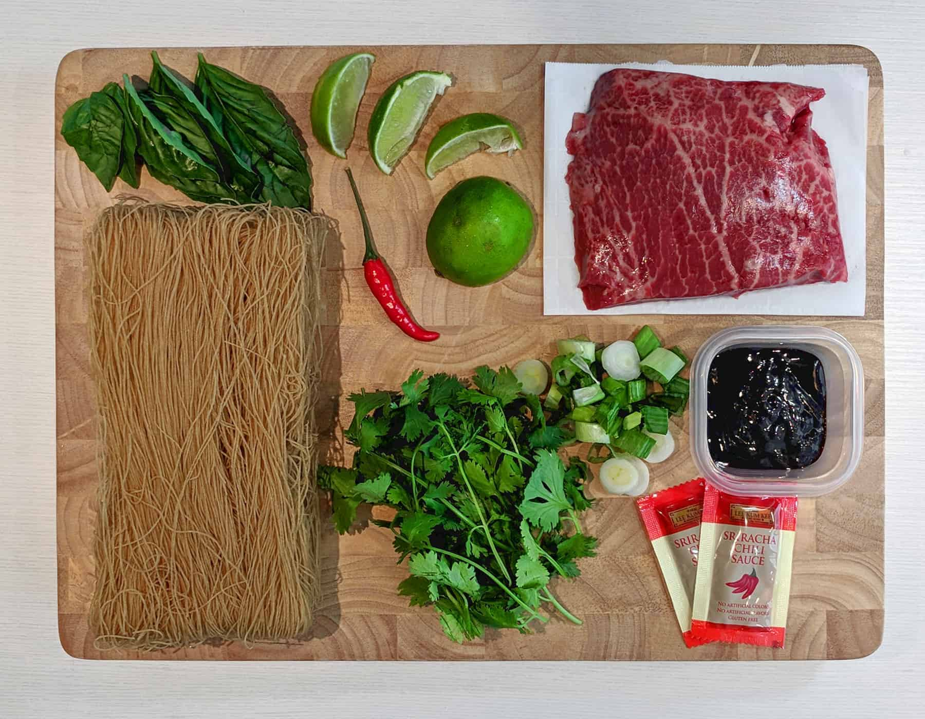 pho ingredients on a wood cutting board